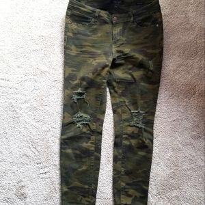 Distressed camo jeans